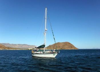 Cruising sailboat heading out